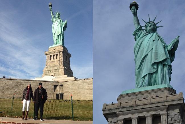 Bem aos pés da Estátua da Liberdade